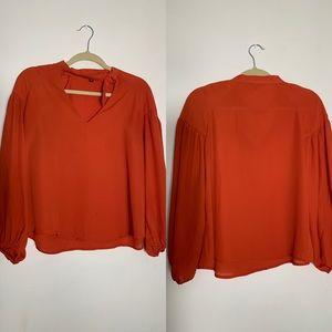 Shinestar | Long sleeve orange shirt. Size M